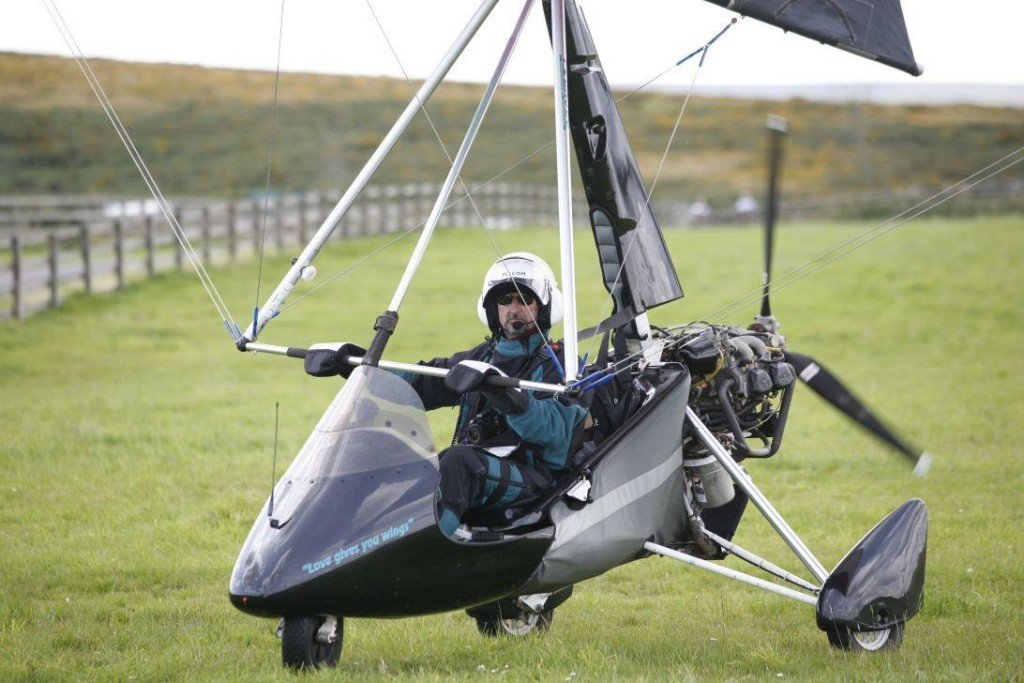 Image no is D090809_followed by the four digits in the image title . David Ramsden, co-founder of and Senior Conservation Officer at the Barn Owl Trust, Ashburton, Devon, England, assembles and flies his Pegasus Quantum 15 microlight from Holwell Downs, near Widecombe-in-the-Moor, Dartmoor, Devon. © photographer Neil Lindsay 2009.